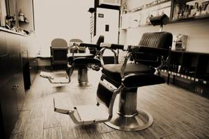 Two rotating barber chairs
