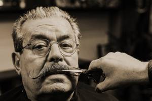 The final touch of a « handlebar » moustache